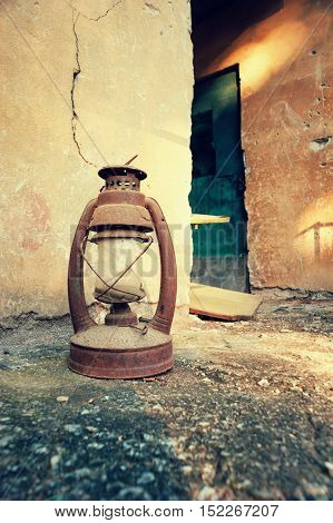 Photography of a old, rusted kerosene lamp