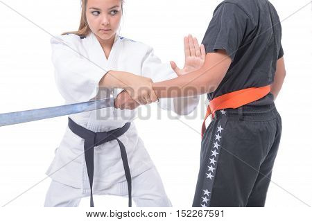 Young athlete exercising with a partner in self-defense.