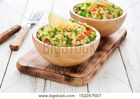 Tabbouleh salad with couscous on a white table