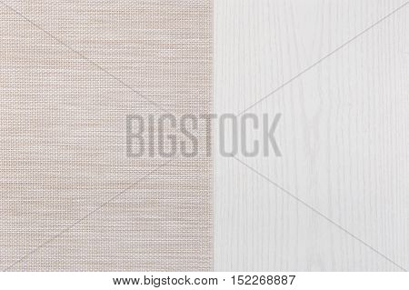Fabric from left side wooden table. Soft brown woven linen fabric texture / white wood texture background.