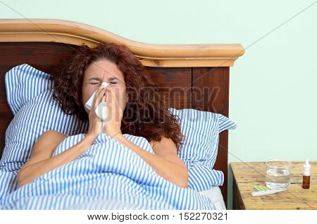 Sick Woman Blowing Nose Into Tissue