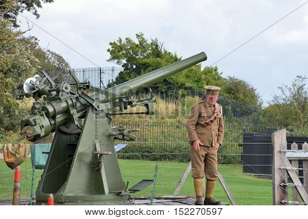 Dover United Kingdom - October 1 2016: Man firing world war two static anti aircraft gun in re-enactment