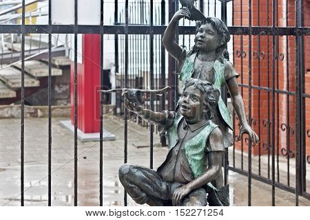 RUSSIA ZELENOGRADSK - OCTOBER 11 2014: Sculpture of a children in the Zelenogradsk promenade. Zelenogradsk (Cranz) is a resort town in Kaliningrad Oblast Russia near the Curonian Spit on the Baltic Sea.