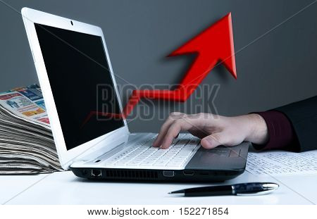 human hand on the notebook keyboard and red arrow