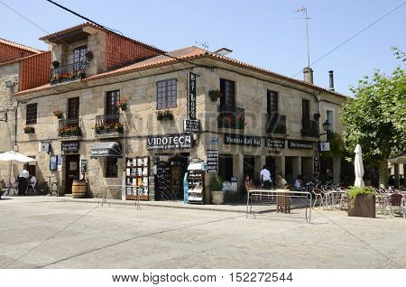 CAMBADOS, SPAIN - AUGUST 8, 2016: Some people in wine bar ia a square in Cambados a town of the province of Pontevedra in Galicia Spain.