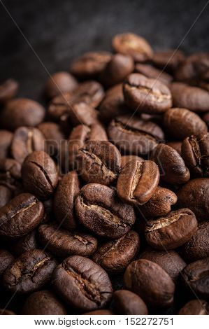 roasted coffee beans on dark background can be used as a background