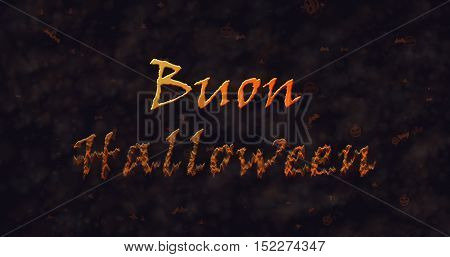 Buon Halloween text in Italian dissolving into dust to bottom