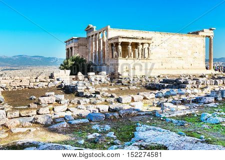 Erechtheum temple ruins decorated with Caryatids female statues in Acropolis