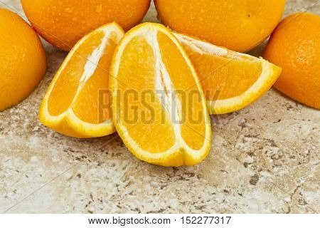 juicy covered orange segments on a textured background
