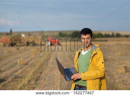 Farmer With Soybean Bale