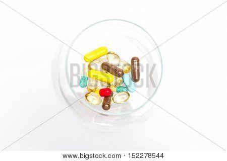Medical Capsules Inside Glass