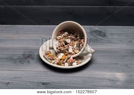 Medical Capsules And Tablets Inside Coffee Cup