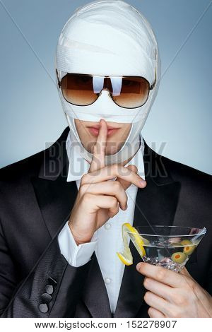 Shh! It's a secret. Celebrity patient in medical bandage and sunglasses after beauty Plastic Surgery. Beauty concept.