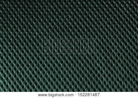 Green fishnet cloth material texture background. Closeup nylon texture from nylon fabric for background and design with copy space for text or image.