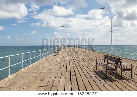 Looking out to sea along the wooden jetty in Limassol, Cyprus