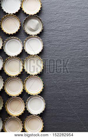 Cover of beer on slate blackboard top view