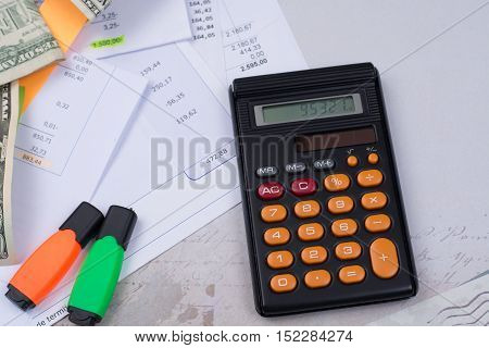 Utility or mortgage bills calculator and US dollars - finance concept payments and problems