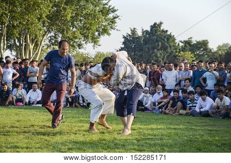 Istanbul Turkey - July 31 2016: Central Asian Turkmen wrestling. in Zeytinburnu district of Istanbul Turkmen wrestling sports events held in the coastal meadows. Turkmen Uzbek Afghan Turkish Turkmenistan Kazakhstan Turkey and other Central Asian youth
