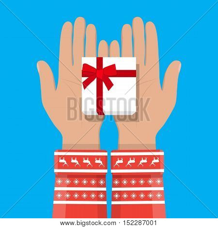 hands in the Christmas sweater holding white gift box with red bow. vector illustration in flat style