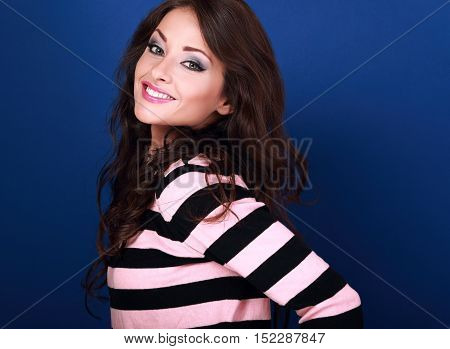 Beautiful Smiling Woman With Curly Long Hair Style Looking Friendly On Blue Background. Closeup Happ
