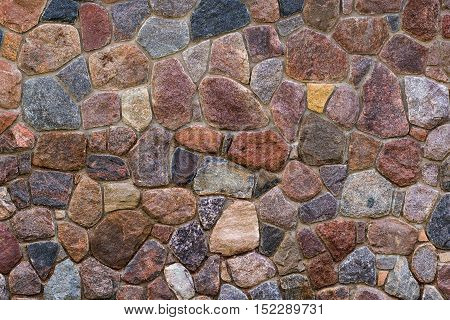 Decorative background for design of texture of stone wall with various color and shape stones