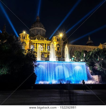 Illuminated National Art museum of Catalonia with fountain in Barcelona Spain at night. Popular landmark dark clear sky
