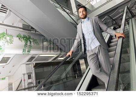 Modern urban man on an escalator. Modern urban man.
