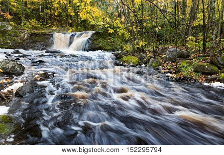 Root Beer Falls in Wakefield Michigan. Tannin rich waters flow over this waterfall in the Upper Peninsula of Michigan during autumn