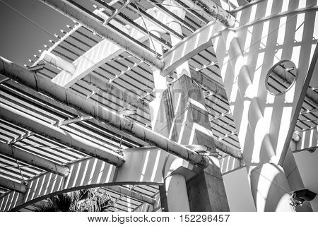 Industry, forged steel structure, metal roof with metal bars and beams