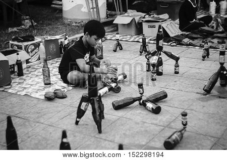 PrachuapkhirikhanThailand -October 14 2016: Unidentified children performs array the bottle at thai traditional market Prachuapkhirikhan ProvinceThailand / High contrast black and white picture style