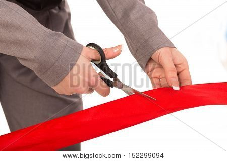 Cutting red ribbon isolated on white, close up