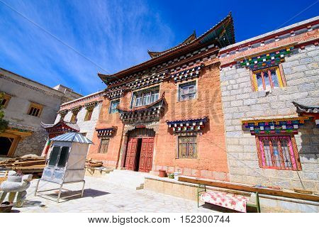 Tibetan Temple brick wall structure in Shangri-la town China with blue sky background