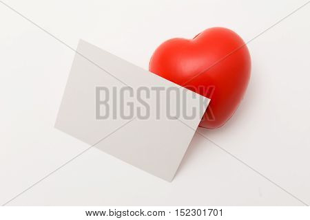 Cute red heart with blank paper sheet isolated on white background