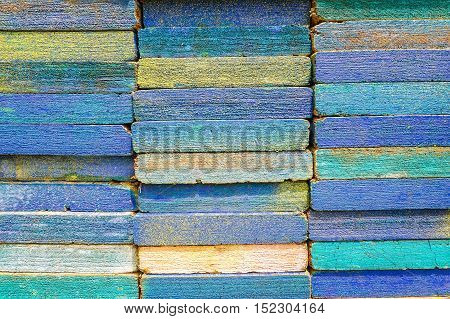 Stack of square wood planks for furniture materials and scaffolding with color paint for background texture.