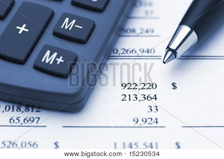 Canculator Pen And Financial Report