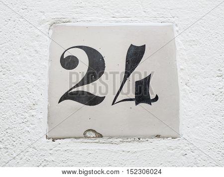 number 24 sign street slab black and white