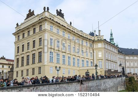 PRAGUE, OCTOBER 15: The crowd of tourists from around the world on the square in front of the entrance to the Old Royal Palace on October 15, 2016 in Prague, Czech Republic.