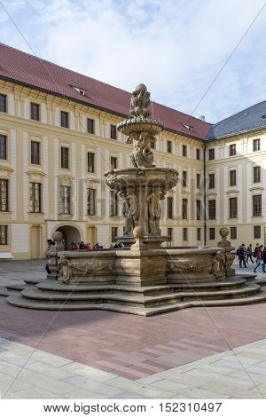 PRAGUE, OCTOBER 15: Tourists in front of a fountain on the Second Courtyard in Prague Castle  on October 15, 2016 in Prague, Czech Republic.