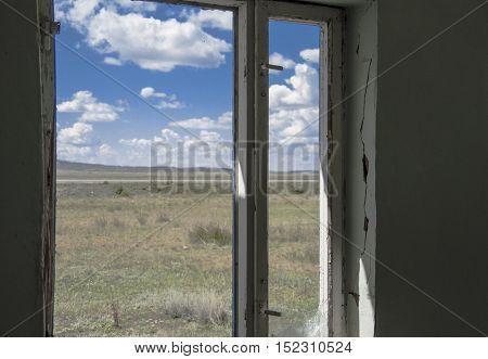 Abandoned room interior with broken window