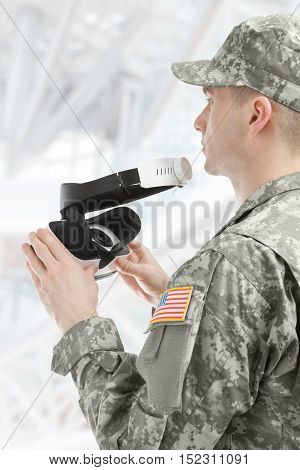 Indoors Shot Of American Soldier Holding Vr Glasses