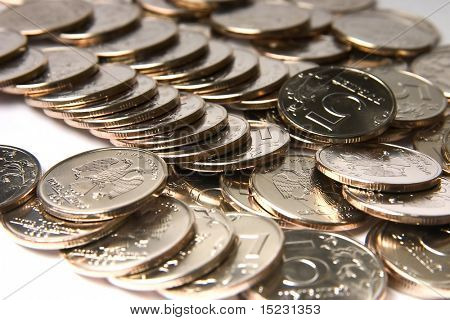 Many coins Russian Federation dignity 5 rubles scattered on white background