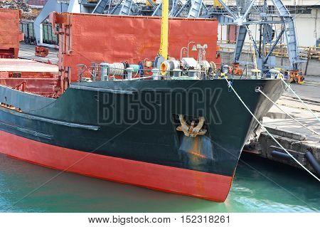 Bulk cargo ship under port crane bridge Odessa Ukraine