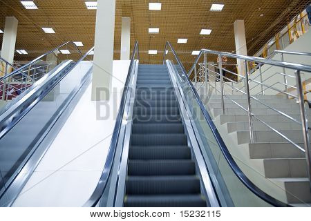 moving escalator of modern large shopping centre or the airport