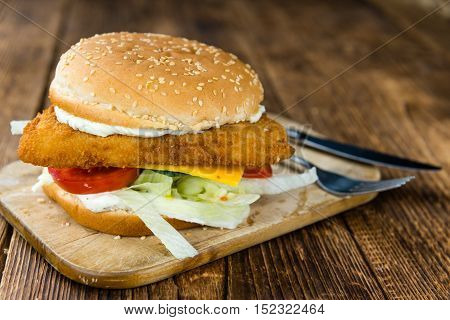 Fish Burger On Wooden Background