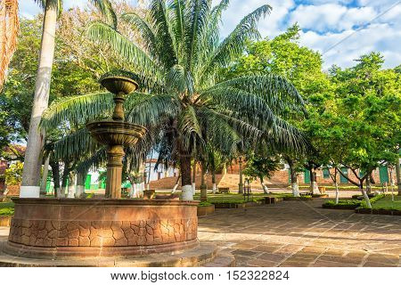 Colonial Fountain In Plaza