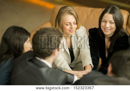 business team sitting in office on a couch and discussing the work plan
