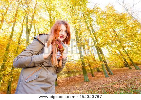 Young Lady Walking Through Park.