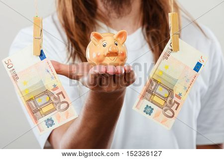 Man Holding Moneybox Piggybank