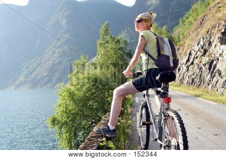 Active Woman On Bicycle Is Having Break