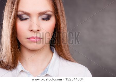 Elegance and beauty of women. Close up of female face with beautiful elegant dark eyes make up. Young woman with stunning amazing facial look.